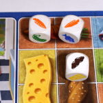 3 dice: carrot, carrot, bread; placed on matching food squares