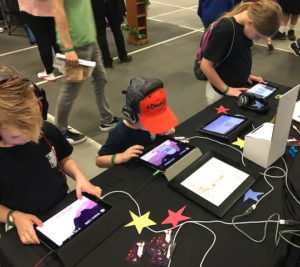 3 children playing iPad games