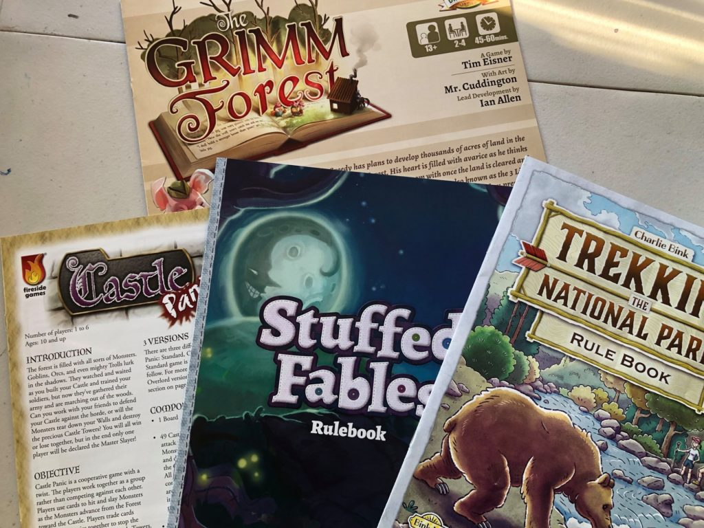 Rulebooks: The Grimm Forest, Castle Panic, Stuffed Fables, Trekking the National Parks