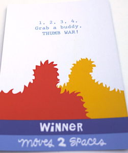 Card text: 1,2,3,4, Grab a buddy. Thumb War! Winner moves 2 spaces.