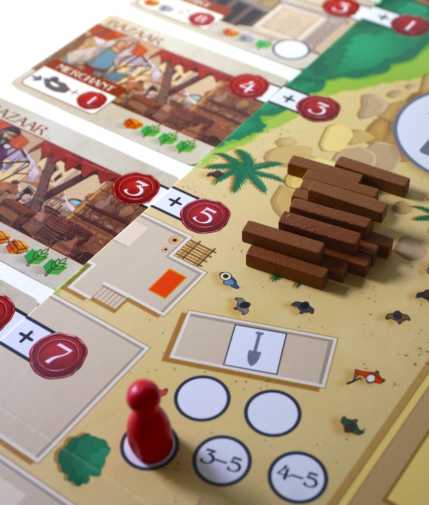 """Wisdom of Solomon: Four building cards and a stack of small brown sticks representing """"roads""""."""