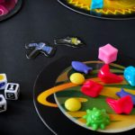 Astro Trash board game passing yellow trash to the sun